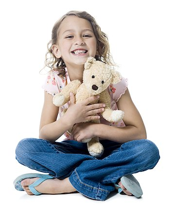 preteen kissing - Portrait of a girl hugging a teddy bear Stock Photo - Premium Royalty-Free, Code: 640-02766996