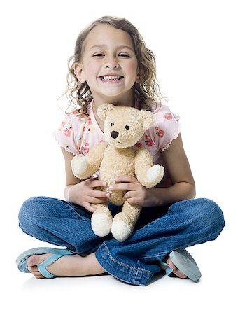 preteen kissing - Portrait of a girl hugging a teddy bear Stock Photo - Premium Royalty-Free, Code: 640-02766997