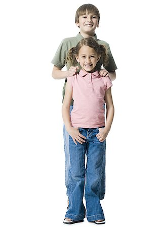 preteen thong - Portrait of a boy standing with his sister Stock Photo - Premium Royalty-Free, Code: 640-02767003