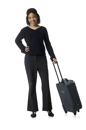 Portrait of a teenage girl walking with luggage Stock Photo - Premium Royalty-Free, Code: 640-02767025