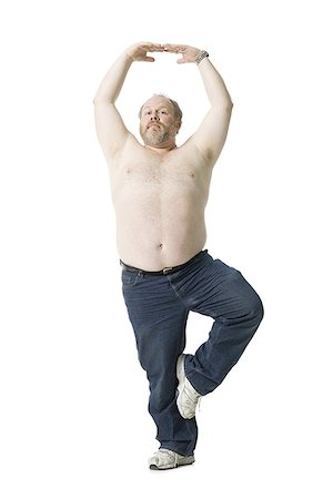 fat man exercising - Close-up of a mature man standing on one leg Stock Photo - Premium Royalty-Free, Code: 640-02767034