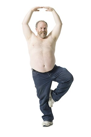 fat man exercising - Close-up of a mature man standing on one leg Stock Photo - Premium Royalty-Free, Code: 640-02767035