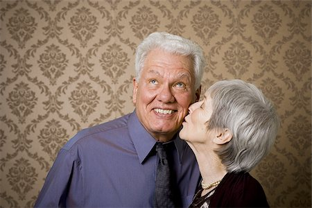 Close-up of an elderly woman kissing an elderly man Stock Photo - Premium Royalty-Free, Code: 640-02767067