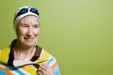 seniors and swim cap - Close-up of a senior woman wearing a swimming cap and swimming goggles Stock Photo - Premium Royalty-Free, Code: 640-02768330