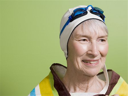 seniors and swim cap - Close-up of a senior woman wearing a swimming cap and swimming goggles Stock Photo - Premium Royalty-Free, Code: 640-02768331
