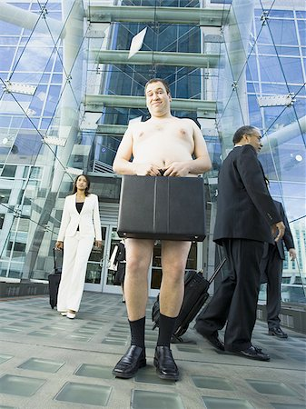 Low angle view of a naked man holding a briefcase Stock Photo - Premium Royalty-Free, Code: 640-02768420