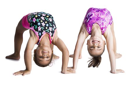 Young female gymnasts bending backwards Stock Photo - Premium Royalty-Free, Code: 640-02768444