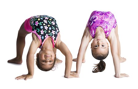 Young female gymnasts bending backwards Stock Photo - Premium Royalty-Free, Code: 640-02768443