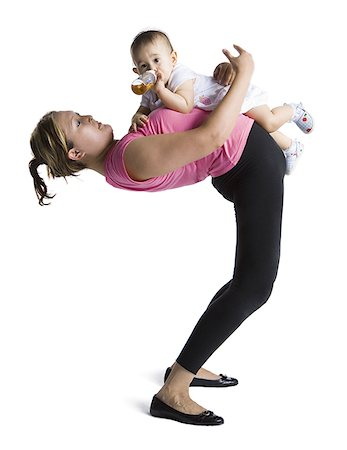 Contortionist mother with baby daughter Stock Photo - Premium Royalty-Free, Code: 640-02768488