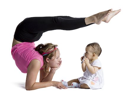 Contortionist mother with baby daughter Stock Photo - Premium Royalty-Free, Code: 640-02768499