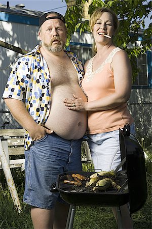 Overweight couple in a trailer park Stock Photo - Premium Royalty-Free, Code: 640-02769464
