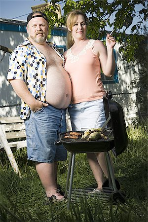 Overweight couple in a trailer park Stock Photo - Premium Royalty-Free, Code: 640-02769465