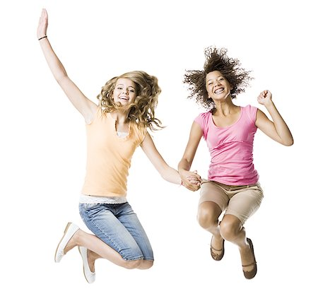 Two girls with braces holding hands and leaping Stock Photo - Premium Royalty-Free, Code: 640-02775297