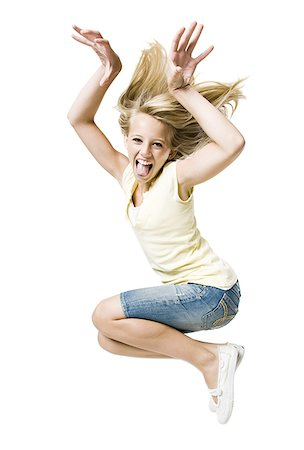 Girl smiling and leaping with hand up Stock Photo - Premium Royalty-Free, Code: 640-02775318