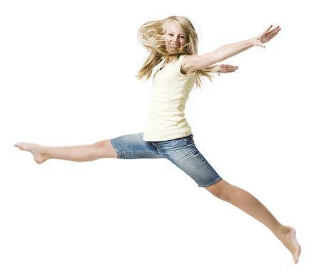 Girl leaping and smiling with arms up Stock Photo - Premium Royalty-Free, Code: 640-02775311