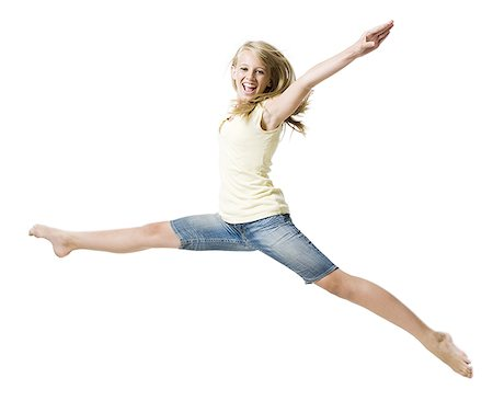 Girl leaping and smiling with arms up Stock Photo - Premium Royalty-Free, Code: 640-02775312