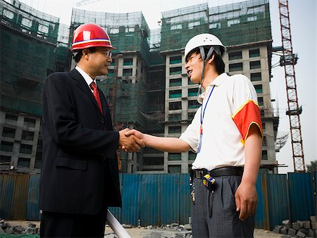 planner - Construction foreman and worker outdoors shaking hands Stock Photo - Premium Royalty-Free, Code: 640-02775467