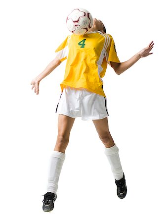 Teenage girl heading soccer ball Stock Photo - Premium Royalty-Free, Code: 640-02775900