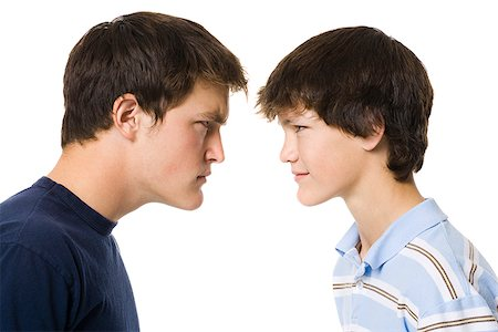 older boy and younger boy head to head. Stock Photo - Premium Royalty-Free, Code: 640-02777522