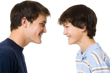 older boy and younger boy head to head. Stock Photo - Premium Royalty-Free, Code: 640-02777523