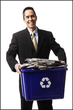 businessperson holding a recycling bin Stock Photo - Premium Royalty-Free, Code: 640-02778408