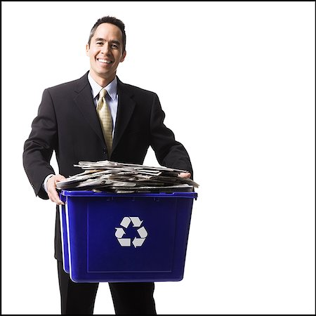 businessperson holding a recycling bin Stock Photo - Premium Royalty-Free, Code: 640-02778409