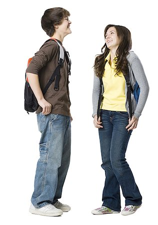 Students with book bags posing Stock Photo - Premium Royalty-Free, Code: 640-02778585