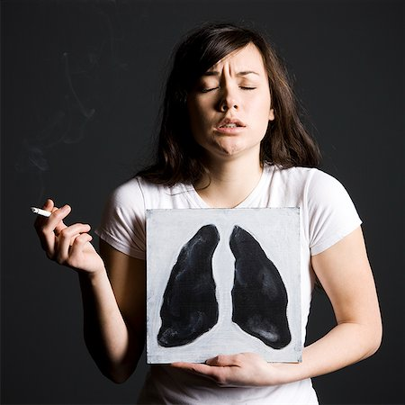 Woman smoker Stock Photo - Premium Royalty-Free, Code: 640-02778817