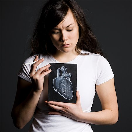 Woman smoker Stock Photo - Premium Royalty-Free, Code: 640-02778819