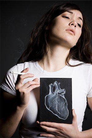 Woman smoker Stock Photo - Premium Royalty-Free, Code: 640-02778820