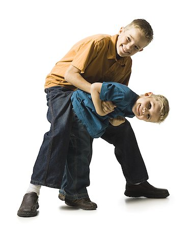 Two brothers wrestling and play fighting Stock Photo - Premium Royalty-Free, Code: 640-02770460
