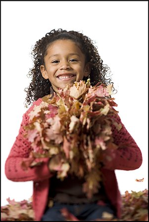 pile leaves playing - Young girl playing in fallen leaves Stock Photo - Premium Royalty-Free, Code: 640-02770515