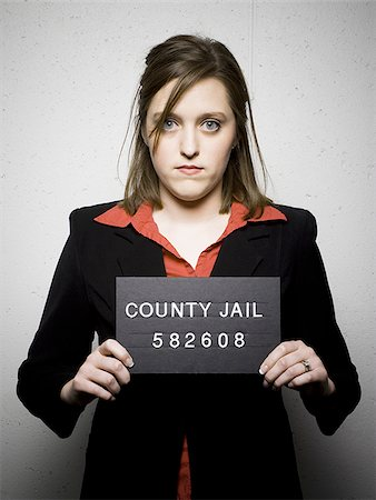Mug shot of woman in business attire Stock Photo - Premium Royalty-Free, Code: 640-02770785