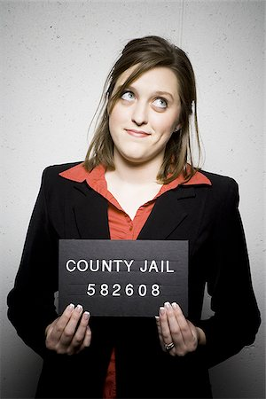 Mug shot of woman in business attire Stock Photo - Premium Royalty-Free, Code: 640-02770786