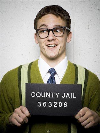 Mug shot of nerd with glasses Stock Photo - Premium Royalty-Free, Code: 640-02771025