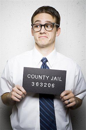 Mug shot of nerd with glasses Stock Photo - Premium Royalty-Free, Code: 640-02771023