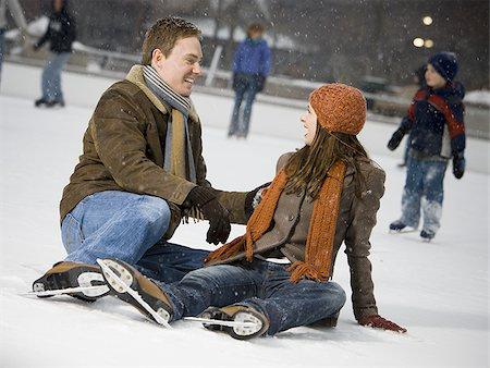 Couple falling while ice skating Stock Photo - Premium Royalty-Free, Code: 640-02772464