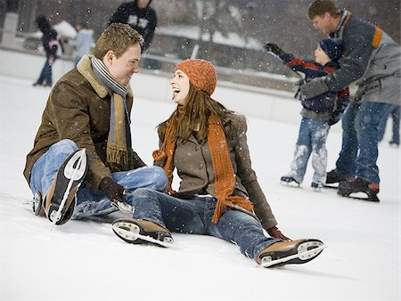 Couple falling while ice skating Stock Photo - Premium Royalty-Free, Code: 640-02772465