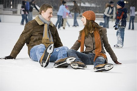 Couple falling while ice skating Stock Photo - Premium Royalty-Free, Code: 640-02772466