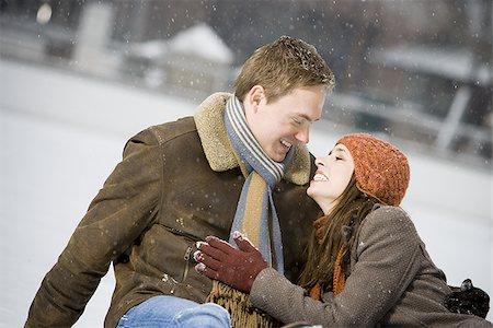 Couple falling while ice skating Stock Photo - Premium Royalty-Free, Code: 640-02772467