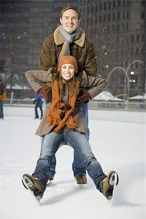Couple falling while ice skating Stock Photo - Premium Royalty-Free, Code: 640-02772460