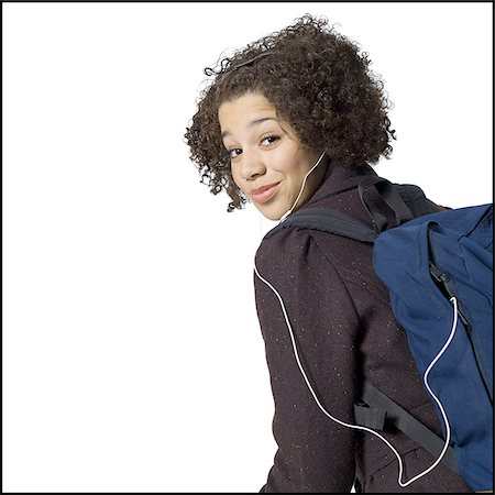 preteen  smile  one  alone - Girl with backpack and earbuds smiling with braces Stock Photo - Premium Royalty-Free, Code: 640-02772649