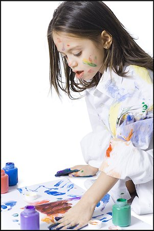 finger painting - Young girl finger painting Stock Photo - Premium Royalty-Free, Code: 640-02772746