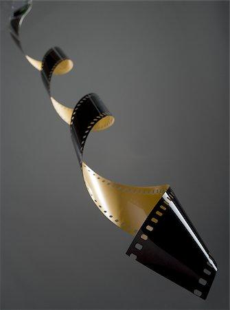 film strip - Coiled film strip Stock Photo - Premium Royalty-Free, Code: 640-02773431