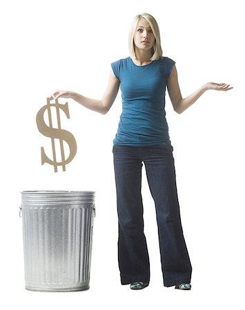 woman throwing dollar symbol in the trash Stock Photo - Premium Royalty-Free, Code: 640-02948369