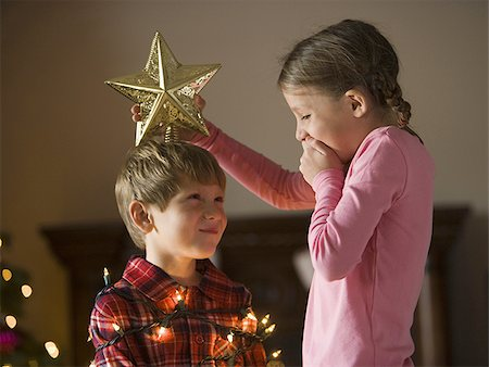 brother and sister at christmas Stock Photo - Premium Royalty-Free, Code: 640-02949347