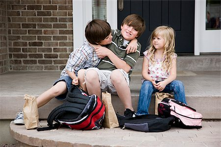 brothers fighting as little sister watches Stock Photo - Premium Royalty-Free, Code: 640-02949853