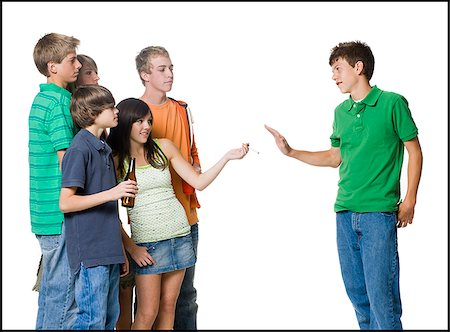 group of teenagers offering another a cigarette Stock Photo - Premium Royalty-Free, Code: 640-02950013