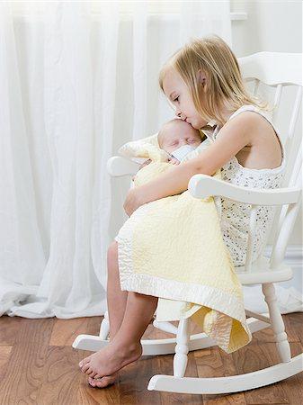 big sister holding her newborn brother Stock Photo - Premium Royalty-Free, Code: 640-02951218