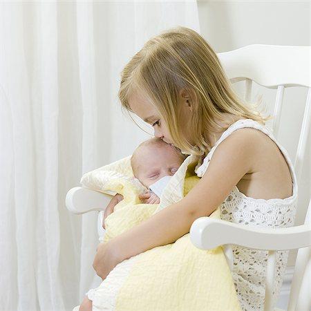 big sister holding her newborn brother Stock Photo - Premium Royalty-Free, Code: 640-02951220